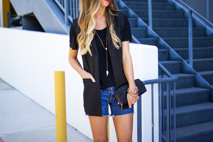 black vest and jeans shorts